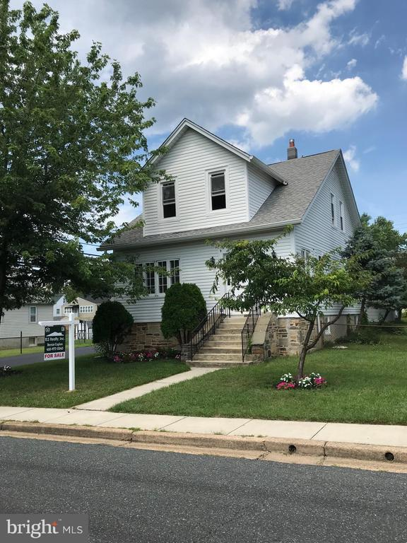 Gorgeous renovation of this magnificent 3 bedroom 2 bath colonial on beautiful corner lot!  Kitchen features granite counters, SS appliances; Hardwood Floors; Detached 2 car garage