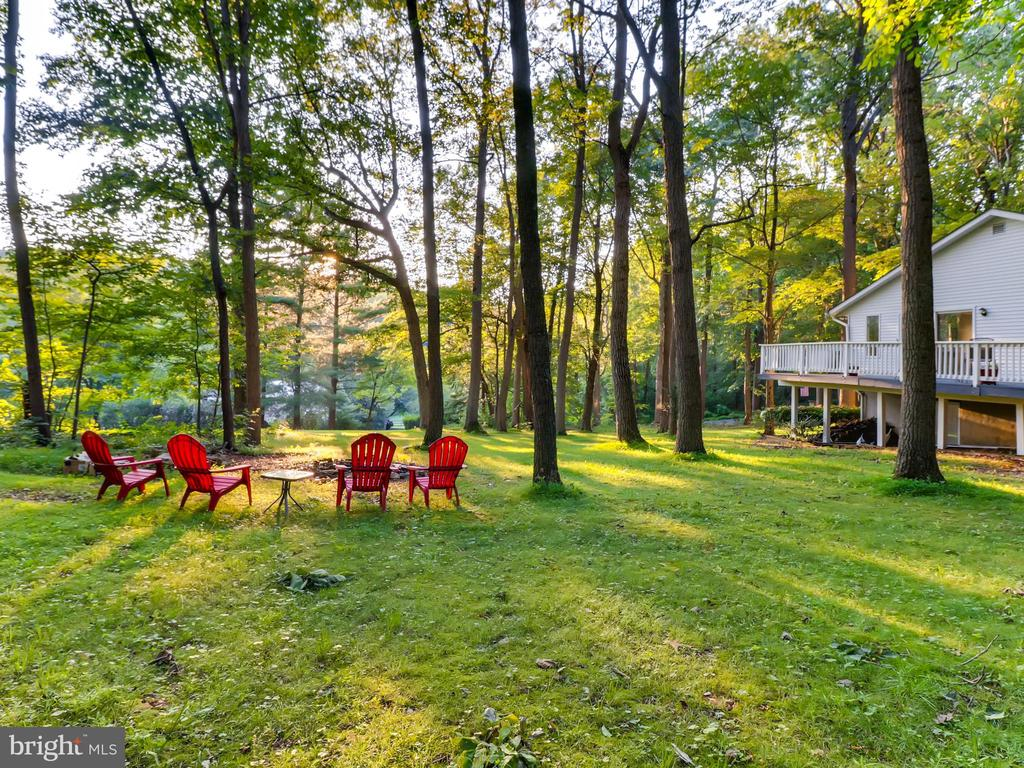 OPEN SAT OCT 12 TH 100-230pm WOW NEW AT  $369,900  FOR HOME W/OVER 2,500 sq ft, 2+ ACRES 4BRS,2.5 Bas COME SEE THE 2 STORY ADDTION W/ MASTER SUITE AND PRIVAT DECK OVERLOOKING THE WOODS AND LAWN NEW painted thru out, NEW 2019 kitchen appliances, NEW 2019 washer/dryer NEW 2019  HW FLs 1st level, NEW 2019 updated ALL bathrooms & kitchen, Open Floor Plan DR Rm & LR Rm w/ wood burning FP.,Family Room, HOME FEATURES- SEPRATE 3 CAR GARAGE & ATTACHED 2 CAR GARAGE NEW Carrrra quarts counters w/ vaulted ceilings ,skylights ,sliders, exercise room ,storage rm , 2 spacious decks the length of the home,