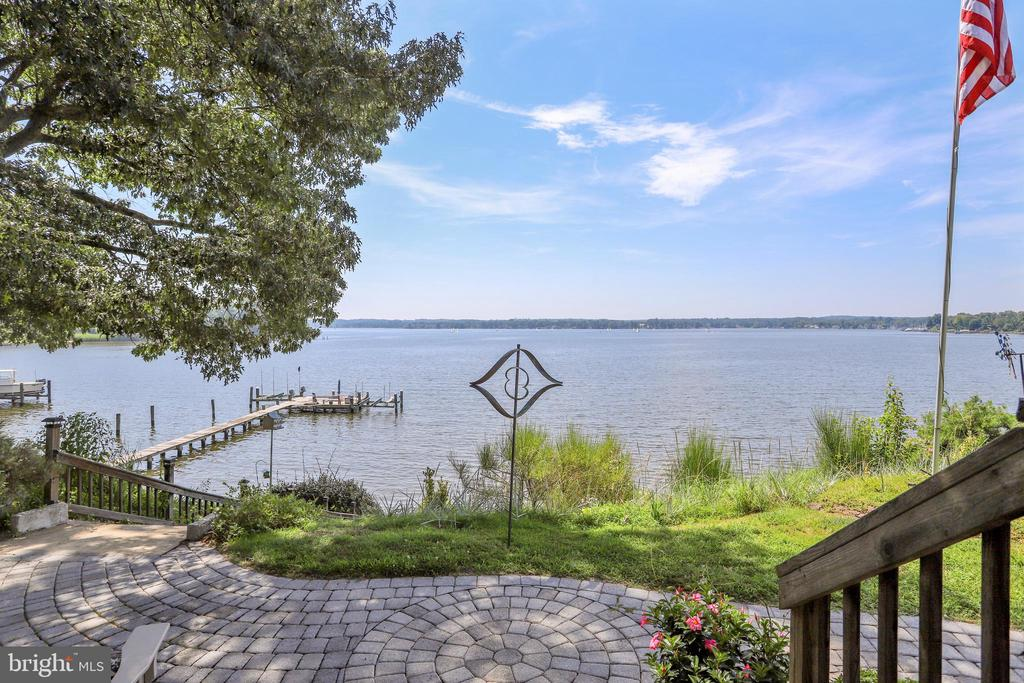 Come by and see this lovely home on Steedmans Point with majestic views of the Magothy River. This unique home is setup as two houses, a main house and an attached summer cottage. The main house, which was completed renovated and added a 2nd floor on in 2005, offers three bedrooms, two baths, an updated kitchen and bathrooms, an office or den, large pantry, main level laundry room, a sun room, a deck off the family room, two-zone heating and cooling and simply amazing views of the Magothy River. The master suite is the second level of this home and features a large bedroom, attached full luxury bath, walk-in closets and access to a large partially finished attic. The attached summer cottage has three bedrooms, one full bath, an efficiency kitchen and amazing views of the Magothy River. Please note: the summer cottage does not have heat but does have a window unit for A/C. The waterfront of this home features a patio, steps down to the boardwalk leading to a large, long pier with two over 10,000-pound boat lifts. Living here you will enjoy all of the amazing sunrises and sunsets over the Magothy plus all of the benefits of water front living. Home is shown by appointment only, call a Realtor today for a showing.