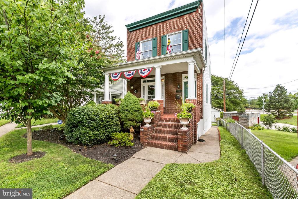 """Price has been reduced to $257000. """"You will love this delightful 3-story brick porch front colonial with old-world charm and modern upgrades. This 3-bedroom home has a 1-car garage, 1,620 sq. ft. of spacious elegance, natural hardwood floors throughout, and a modern gourmet galley kitchen. Imagine cuddling up with a good book or better yet a cocktail on the front porch. It also features CAC, a renovated bathroom and replacement windows. All of this situated in a convenient community just 8 minutes to downtown and less than a mile to the colorful restaurants and shops in Hampden."""""""