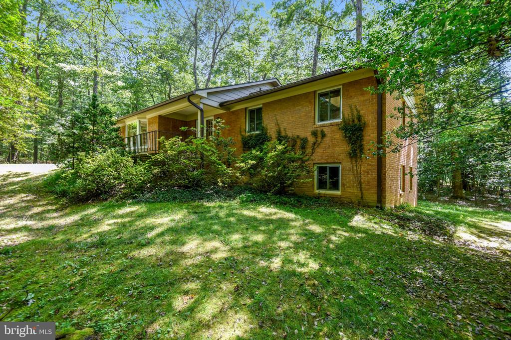 New Price! Commuters Dream! 3 miles to Wiehle-Reston METRO, 2 miles to Dulles Toll-267 via Reston Pkwy. HUGE INLAW/AU PAIR SUITE (4th-5th BR) awaits you w/remodeled bathroom...complete privacy w/pocket doors & exterior entrance. Private and secluded park-like tree/wooded corner lot, this welcoming home at 2831 sq ft is a entertainer's delight in highly desired Reston, FX County. Hardieplank Siding/Brick, Hardwood floors, remodeled gourmet kitchen leading into a open dining room/living room...brings you outdoors to a 22 x 22 private deck, a perfect setting for family and friends gatherings.   Back indoors on the MAIN LEVEL (1479 sq ft), you will find the OWNER'S SUITE and two guest bedrooms-with two extensively remodeled full bathrooms. Fully Finished Lower Level (1352 sq ft) complete with a full wall of brick & gas fireplace...giving you the opportunity to walk outdoors to your own private space.  Desirable two car garage, Special order window shutters, kitchen cabinetry rollouts, hardwood floors, freshly painted, extra storage in basement, additional attic flooring above garage, washer/dryer/extra refrigerator convey.