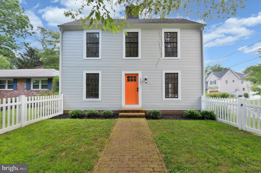 Those doors give the perfect pop of color to the the simplistic and clean lines of this stunning colonial style saltbox in the heart of historic Haddonfield. Originally built in 1990 and fully renovated in recent years, this home with a total of 3,095 sq. ft of living space, has all the modern and upscale features of a new home! Adding even more importance to this property is the location overlooking preserved woods on one of the most secluded streets in Haddonfield.  The home reflects many details found in older homes with the peace of mind of a newer home. Notable details include gorgeous hardwood flooring, white painted walls all accented by wide window moldings, ship lap wainscoting in the Living Room, charming brick fireplace. A first floor bedroom with attached full bathroom makes a possible inlaw or aupair suite, or use the room as best meets your needs. There is  a spectacular gourmet Kitchen with coordinating white and finished wood cabinetry, light granite tops, stainless steel appliances, gleaming white subway tile back-splash and large dining area.  The windows throughout the home are gorgeous and flood the living ares with natural light while providing great views of the peaceful surroundings. A side entry hallway offers a great place to stash your stuff when you enter and there's a Powder Room located here for convenience. The upper level includes 3 additional bedrooms and 2 gorgeous tiled bathrooms. There's a walk in closet in the Master and the laundry room adds more convenience. An additional 850 square feet has been added to the floor plan with the full finished basement which is the perfect place to entertain and relax. The picket fenced rear yard adds Americana charm to the whole property and encloses a large grassy area and deck for play and enjoyment. A detached one car + storage garage with brick driveway completes the charming picture.  Haddonfield is consistently voted as one of the best towns to live in. Walk to local parks, the town pool, shopping and schools. Quick access to public transportation, major highways.  Live life as it was meant to be! Won't last long!