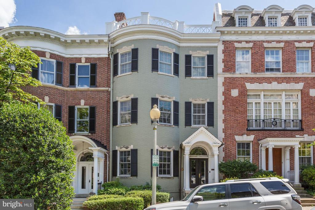 FANTASTIC PRICE ADJUSTMENT!  A most architecturally and historically important house on one of Washington's loveliest blocks, 2110 Bancroft Place is an exceptionally beautiful house of grace and grandeur.  It offers refined proportions and details inside and out including a beautiful semi-circular fanlight entry, original staircase and seven fireplaces. There is parking  and a roof terrace.~ The grand house of close to 5000 square feet was designed in 1899 by architect Lemuel Norris and built by William Lipscomb who also built the former Textile Museum on S Street among many other prominent buildings. 2110 Bancroft originally sat just to the east in the location of 2108 Bancroft (which was built later) and was moved to its current location in 1907! It is reportedly the first example of a Federal bow-front style house in Kalorama and the first house built on the south side of Bancroft Place. The current owners have lived in the house for 48 years during which time many improvements have been made.  There are gorgeous public rooms and large bedrooms.  The lower level has separate front and rear entrances and includes a bedroom and bath suitable for guests or staff with easy access to the upper main house and also the  front English basement entrance.  In addition, the LL has an in-law efficiency apartment or great  home office with separate rear entrance.~ Please see Virtual Tour for more photos and floor plans.