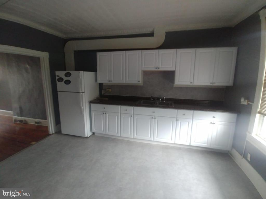 BEAUTIFUL FULLED RENEOVATED ROWHOME WITH LOTS OF CHARM * GORGOUS WOOD FLOORS THROUGHOUT * TOTALLY RENOVATED BRAND NEW KITCHEN AND BATHROOM* CALL ME TODAY IT WON'T LAST LONG