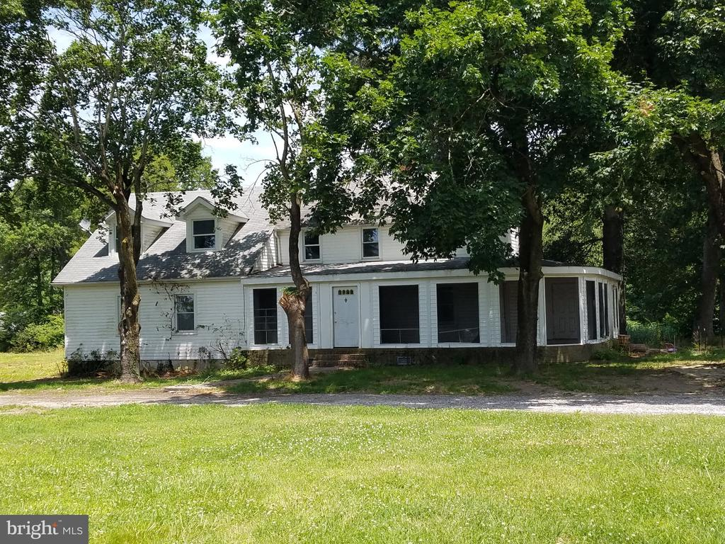 16.4 Acre Farm with House and 2000 sqft Steel Garage, Fields/Pastures for Horses,  Deer, Turkeys geese and a pond for Ducks , Hunting in your backyard , House needs TLC and updating, newer well installed , Completely new Septic System/Holding Tank etc.. replaced Sept 2020