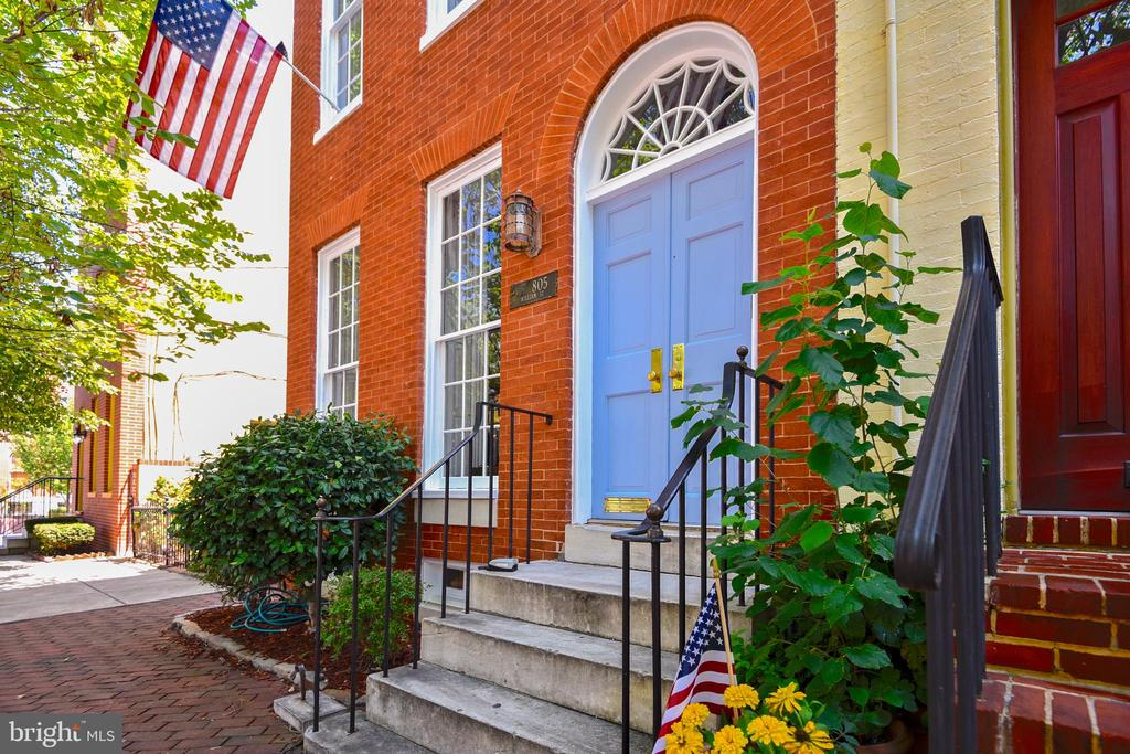 One of Historic Federal Hill's finest homes on the premier block of William Street, one block from the Inner Harbor and Federal Hill Park. This grand, bright, beautifully restored end of group townhouse boasts large rooms, high ceilings & hardwood floors throughout as well as exterior space on every level. Traditional design details including crown molding, chair rails, interior wooden shutters and built-in cabinetry. First floor features living room, separate dining room, and large kitchen with separate eating area overlooking the private courtyard patio. Second floor is home to the master bedroom, as well as a second bedroom with attached dressing/sitting room and French doors to a cozy covered deck. Third level has two additional bedrooms, one of which is extra large which makes a perfect kids bedroom/playroom. Third floor also has a small deck with stairs up to roof-top deck with 360 degree panoramic views. Plenty of space inside and out for comfortable living and entertaining!