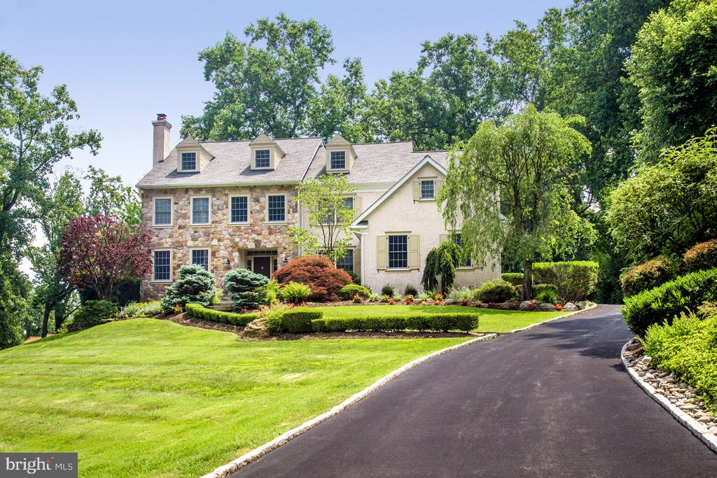 This move-in ready, pristine condition 5 bedroom, 4 full bathroom, 2 half bathroom home is on a landscaped wooded lot, on one of the most prestigious, sought-after streets in Gladwyne! Nestled on a quiet cul-de-sac, this expansive 6,200+ sq ft residence enjoys peace, privacy, and an in-ground heated pool with hot tub for the ultimate outdoor enjoyment. Inside, an open, airy 2-story foyer welcomes you into an ambiance of elegance. Abundant natural sunlight streams in through large windows, while exquisite details add classic character such as hardwood floors, extensive millwork and built-ins, including a built-in bar. For entertaining, the layout is superb. Host guests and gather with family in the 2-story great room and spacious, finely-appointed open kitchen where you~ll find culinary inspiration watching the sunrise. The master suite is a luxurious retreat with a spa bath for unwinding. Generous family and guest bedrooms, a 3rd floor suite - perfect for a teenager, nanny or home office, and finished walk-out basement enhance living comfort. Filtered water in the kitchen, a Sonos system with phone app and indoor/outdoor speakers, a new Timberline Weather Watch roof in 2014 with transferable warranty, new skylights in 2014, a new hot water heater and sump pump installed late 2018, whole house generator with warranty, new driveway under 3 years old, and HVAC controlled remotely via Honeywell phone app are among the upgrades and special features. The exceptional location is just a short walk to the quaint village of Gladwyne, and provides direct access to miles of scenic Bridlewild walking trails.