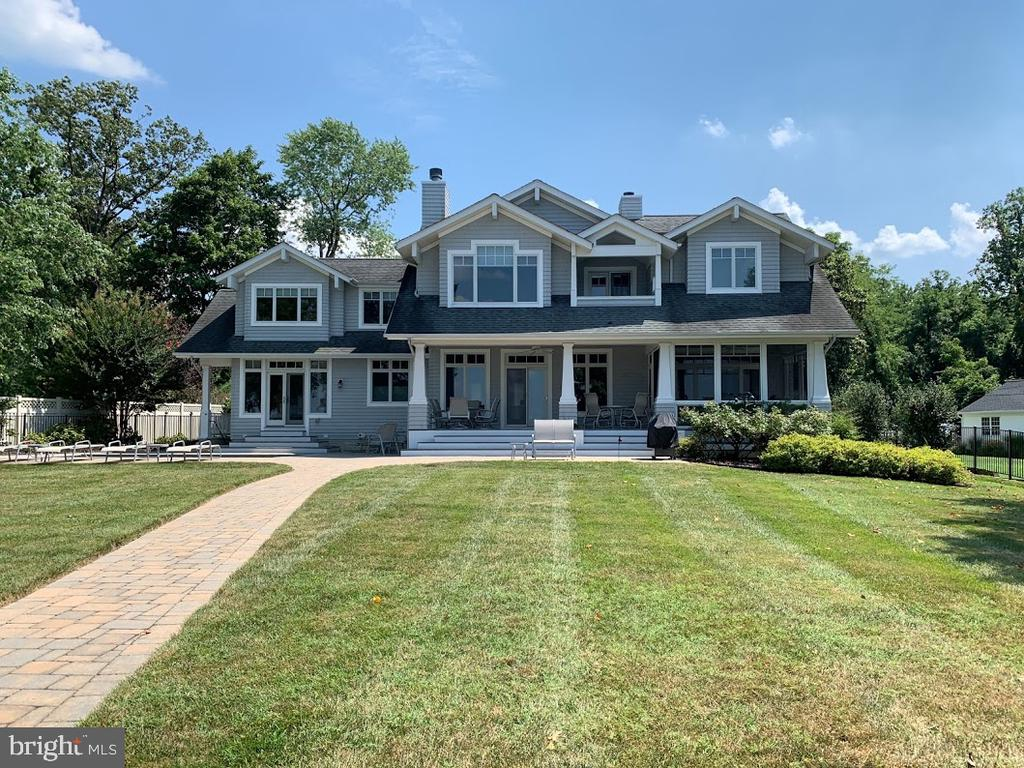 Beautiful custom home located on the Magothy River, within minutes of the Chesapeake Bay. Gorgeous water views from all 4 bedrooms and living areas. Long deep water pier with boat and watercraft lift. Heated pool with automatic cover and spacious fenced yard. Wide open floor plan, combined kitchen dining room with dual islands and breakfast bar. Gourmet kitchen with built in cabinets and additional prep sink. Matching cabinet panels for refrigerator and freezer with dual ovens, warming drawer and larger cook-top. Large walk in butler pantry with kitchen counter-top access. Open living room with incredible views and look through fire place shared with dining room. First floor bedroom/library/office with french doors to patio and pool. Master bedroom with beautiful views includes a private balcony, large walk in closet and double sinks. Spacious second floor with additional area for exercise or game room and separate walk in linen closet.