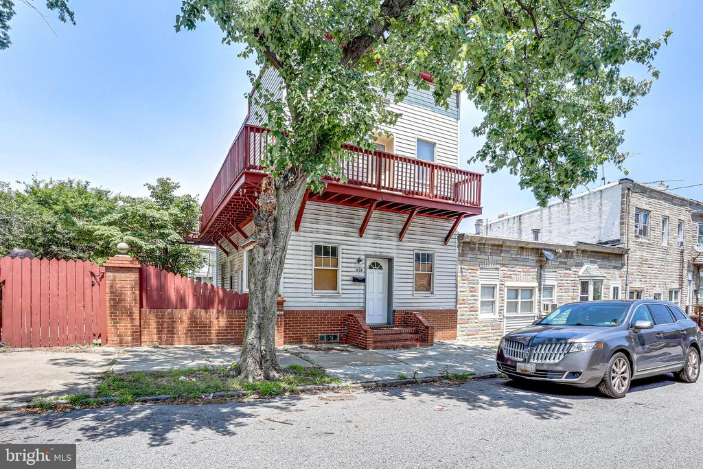 Bring your investors OR live in one and rent out the other! Curtis Bay very large 2 unit townhome w/ adjacent lot! Many updates! Each unit has zoned AC units & heat! 2BR/1BA on each floor! Large wrap around deck on 1st & 2nd floor!