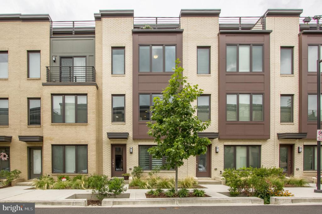 PRICE REDUCED Fabulous EYA four level townhome with roof top terrace.  4 bedroom 4 full baths and side by side 2 car garage.  Upgrades include fireplace in the family room, full bath and beautiful built ins on the lower level.  Pristine condition.