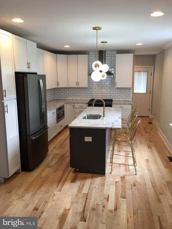 Amazing Home in the Heart of Hampden with completely renovated.  Contemporary Finishes through out with solid hardwoods and gourmet kitchen with large island and stainless steel appliances.  Home comes with oversized walk in closets and large bedrooms.  Very large fenced in back yard and very wide parking pad for 2 cars.
