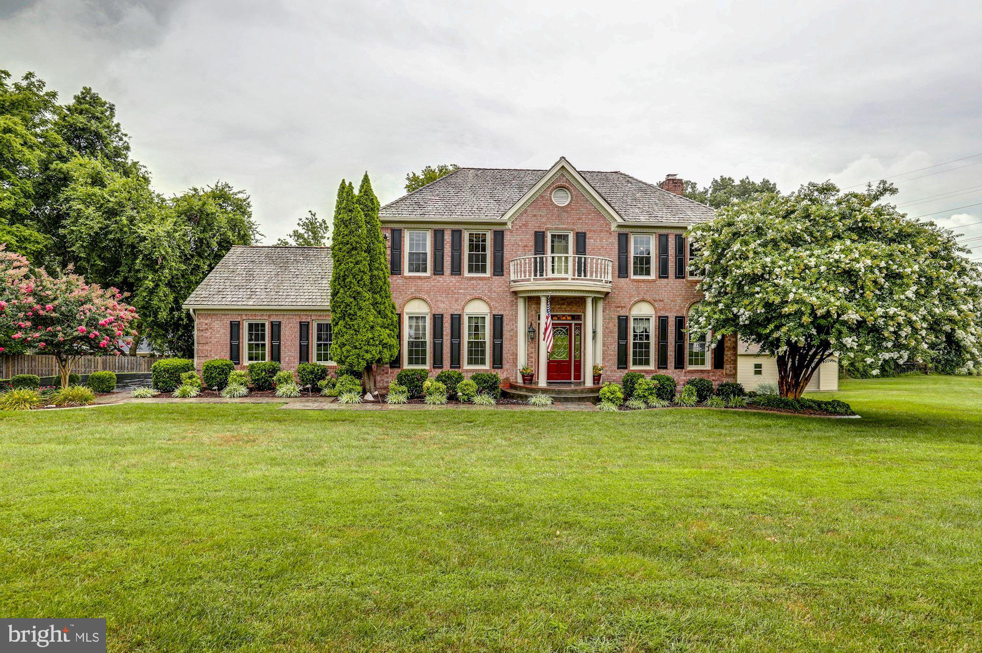 This beautifully renovated Colonial, a former model home, is sited on a gorgeous .83-acre cul-de-sac lot. The home offers over 4300 finished SQFT of well-thought out living space, a 2-car side-loading attached garage, an additional 3-car detached garage w/heating & a/c, workshop and storage area. The home features formal living and dining rooms, a gourmet kitchen that opens to a bright sunroom w/skylights and family room w/gas fireplace, huge master bedroom w/luxury salon bathroom and heated floors. Extensive molding, hardwood and upgraded tile flooring throughout. The finished walk-out basement has a wet bar, exercise room, a den/5th bedroom w/full bathroom. Plenty of outdoor entertaining and living space including composite deck, stone patio and level lawn w/privacy and stunning views. Recent updates include repaving and extended driveway to a newly-built rear detached garage (36x24, insulated, drywall, concrete sidewalk, dedicated 200-amp service with separate meter, split system heating/ac), all new argon filled Anderson windows & skylights, fully renovated bathrooms, capped sidewalk and front stoop w/stamped concrete, new septic pumps, fireplace insert, new paint & flooring, composite decking & rails, new paver patio & knee wall and professional landscaping.