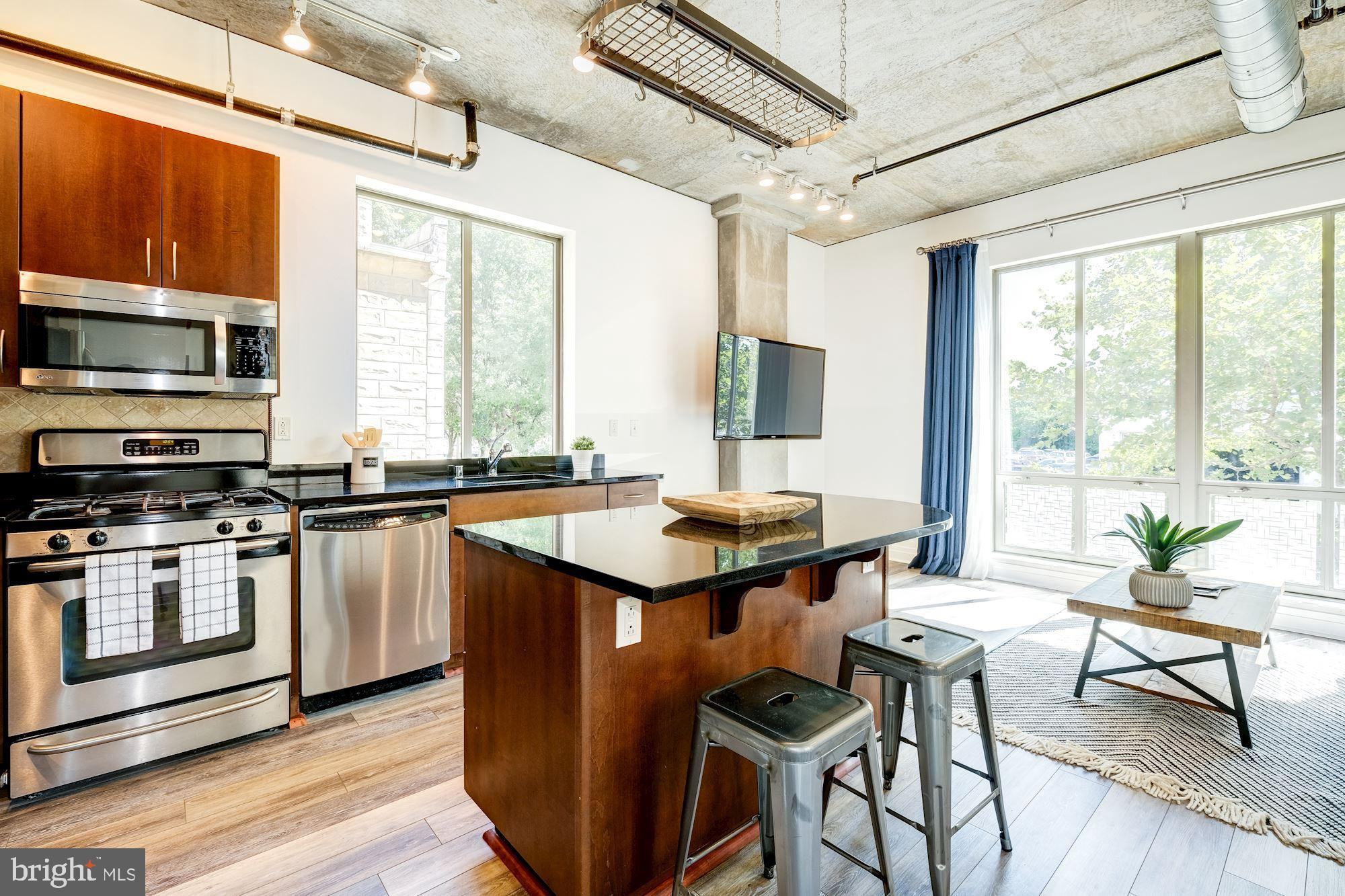 Open House Sunday September 1st 2-4 PM. Beautifully updated TRUE 2 bed/2 bath at the Sonata in Mount Vernon Triangle. Recent updates include new HVAC, new floors, new W/D, beautifully renovated master bath with shower and dual vanities. Soaring ceilings let gracious amounts of light flood in from three exposures in the open living/kitchen/dining space, and looks out to tree-top views. The open living space offers great entertainment space, but also is a cozy little oasis in the middle of the hustle and bustle of the city! Super high ceilings with the industrial feel make this the perfect home! Walk to tons of restaurants, bars, etc, and have easy access to 395 and metros, and tons of new development in the area means more is coming!Condo fee includes great amenities (rooftop, gym, concierge), and parking and storage included. Pet friendly building in the heart of Mount Vernon Triangle, with easy access to just about anywhere!