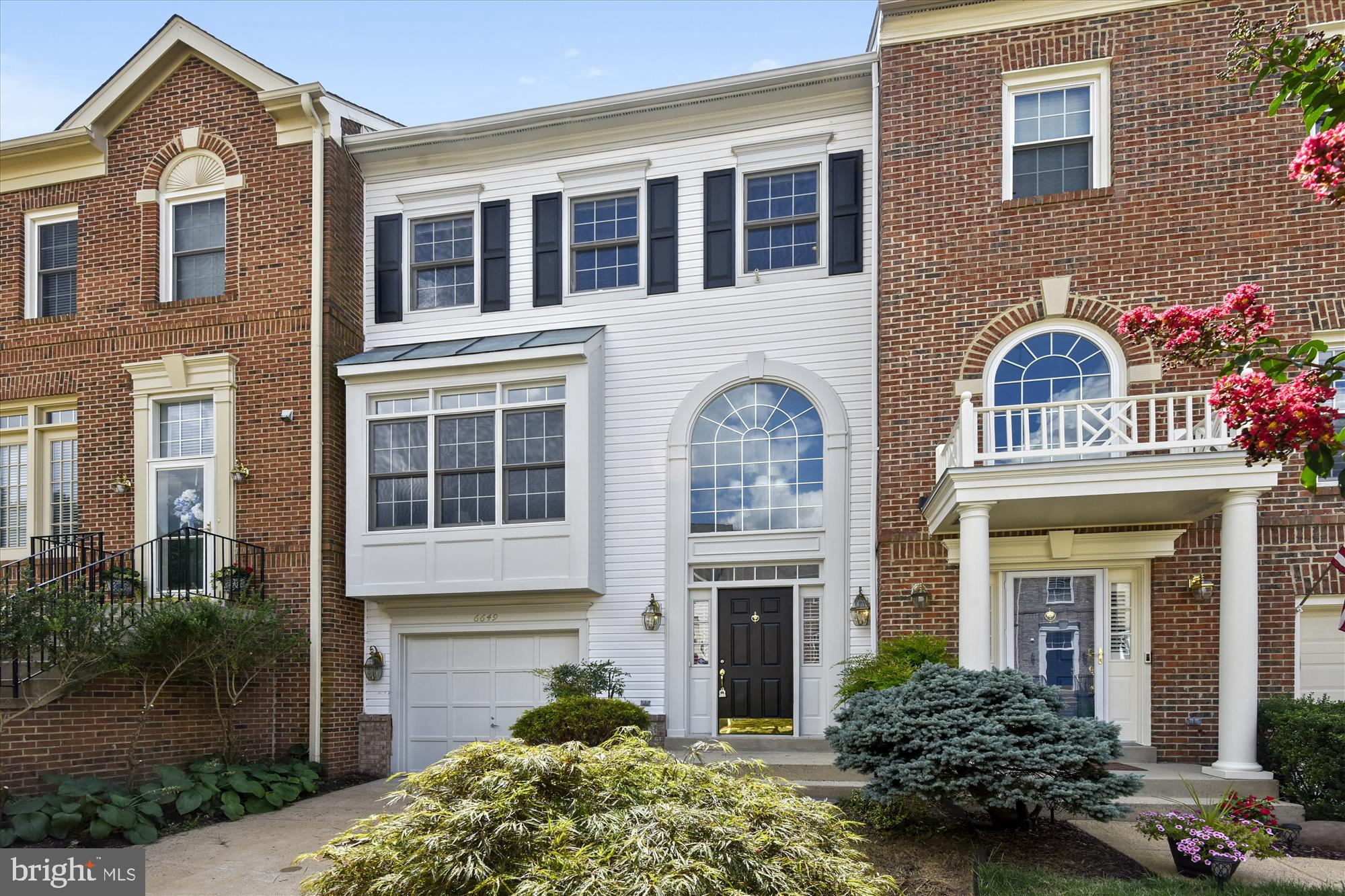 Just What You Have Been Waiting For!  Lovely upgraded 1 car garage townhome located in desirable North Kingstowne neighborhood.  Hardwood floors on 3 levels, with remodeled bathrooms and upgraded kitchen.  2 gas fireplaces located in recreation room and family room. Full bath on lower level- perfect for guests.  Spacious master bedroom suite w/ walk-in closet and remodeled master bathroom.  Luxurious corner shower and dual sinks w/ plenty of room to spread out.  Vaulted ceilings and fans in all bedrooms.  Roof and fridge recently installed.  Newer hot water heater. Short stroll to shops, restaurants and movie theater!