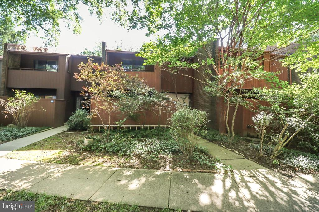 NEEDS WORK* Great location in walking distance to the Reston Town Center * Much of the house is original, but large sized rooms * Hardwood floors in the living room and dining room  * Wood burning fpl