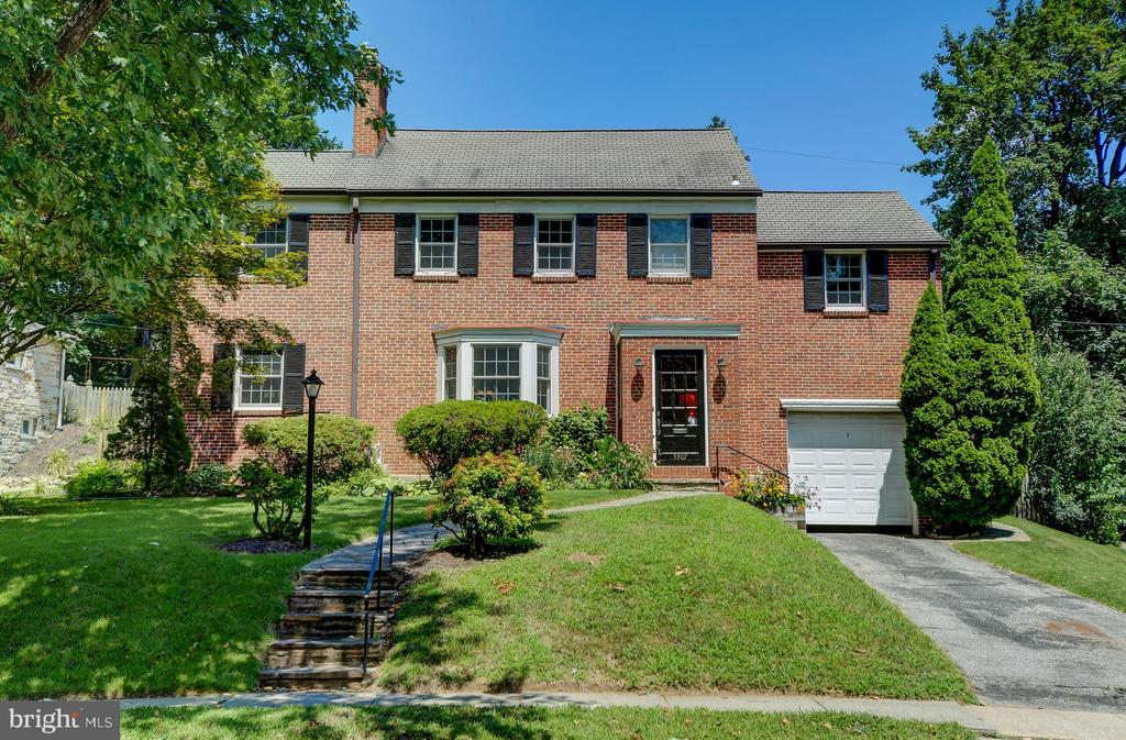 Meticulously maintained brick colonial in the charming, sidewalk and tree-lined Chatham/Orchards neighborhood. Sprawling living room with sun room that leads to large stone patio. New, white and grey chef's kitchen open to dining room and living room. Newly updated lower level with gas fireplace and half bath. Three large bedrooms upstairs - Master with connecting, large office/dressing room and en suite bathroom. Great entertaining space outdoors on the stone patio. Large, fenced backyard offers gardening and mature landscaping. Updated windows and thoughtful upgrades throughout!