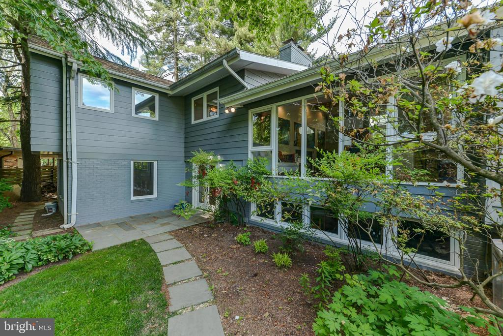 PRICE REDUCED! Looking for a mid-century modern dream home? There's so much to love about this spacious (3500+SF) and beautifully appointed MCM  beauty with contemporary updates and notable indoor/outdoor connection, in highly rated Whitman HS District! Open layout provides amazing flow between primary living areas, which boast vaulted ceilings, floor-to-ceiling double-pane low-e windows, hardwood floors and exposed ridge beam. Covered flagstone and slate entryway opens to welcoming foyer with slate flooring, skylight, display wall, coat closet and powder room. Chefs kitchen includes upgraded granite countertops and full height backsplashes, high-end stainless steel appliances, impressive storage space, breakfast bar and skylight. Spacious living room features gas fireplace with slate hearth and surround, and large storage / display unit. Comfortable, open dining area includes built-in shelving and views to lush backyard. Bright and airy sun room enjoys walls of windows, skylights and direct access to flagstone patio. Expansive yet cozy family room includes wood-burning fireplace, built-in shelving, wet bar and direct access to second flagstone patio. Generous owner's suite with cathedral ceilings, walk-in closet, window seat / storage and ensuite bath with heated tile floors and skylight. 3 additional sizable bedrooms. Private office (could be bedroom 5) with serene views and built-in shelves. Mud room / laundry room between carport and kitchen with built-in storage cabinets, sink and pantry. Semi-finished basement with large storage closets and utility sink. 2 exterior storage rooms plus storage / garbage can closet. Beautifully landscaped site with two patios in backyard, 2 level side yards and grassy level front yard, on dead-end street -- providing lots of safe playing and quiet entertaining space. Make this dream home yours!