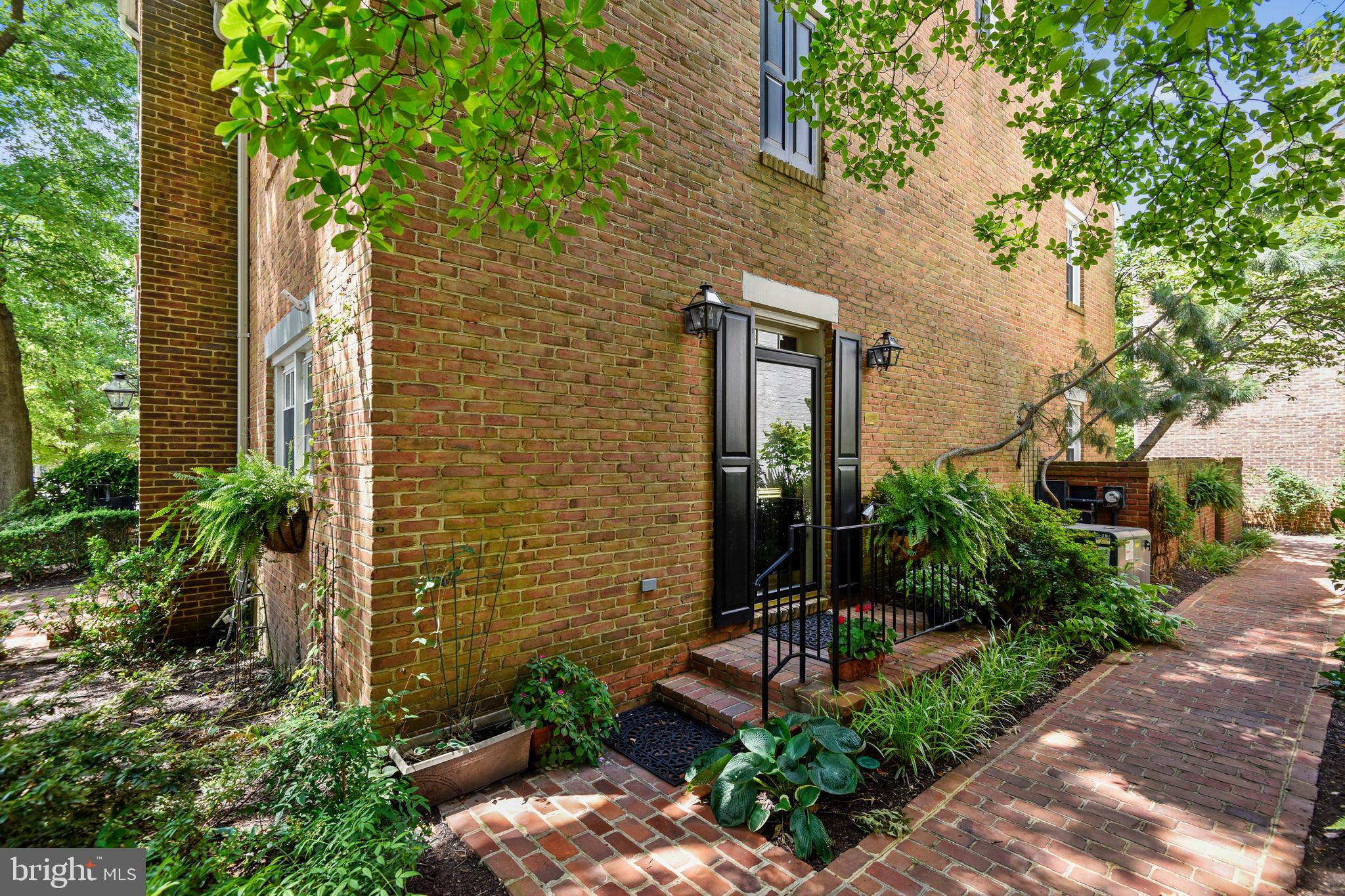 Beautifully renovated Canal Way all brick end-unit town home with 3 bedrooms and 2 full baths in an outstanding location just 1 light from DC. Freshly painted top-to-bottom and move-in ready with just refinished hardwood floors & stairs on all 3 levels, granite counters all new stainless steel appliances in the kitchen and a completely gutted and remodeled full bath on the second level. Two wood burning fireplaces, 1 in the living room and 1 in the master bedroom and the master bedroom also includes a walk-in closet with a custom built-in organizer system. The top floor features the 3rd bedroom, 2nd full updated bath and a very unique loft area overlooking the master bedroom that would make the perfect home office. New stack washer & dryer also included on the 3rd floor. Other notable updates include new outdoor A/C unit March of 2016, new not water heater Dec 2018 and updated thermal pane windows 2010. The living room French doors open onto a charming brick walled patio with a gate opening to a walkway through the common area to your reserved parking space in the community courtyard parking lot. Just .08 of a mile/16 minute walk from the Braddock Rd Metro station and only a few short short blocks from Harris Teeter, Trader Joes, numerous restaurants and shops and the Potomac River waterfront. And I dare I leave out it is just 3.6 miles from Amazons HQ2 in the new National Landing development at Crystal City and the new Virginia Tech Innovation Campus and future Metro stop at Potomac Yard. Yes, you can have it All!