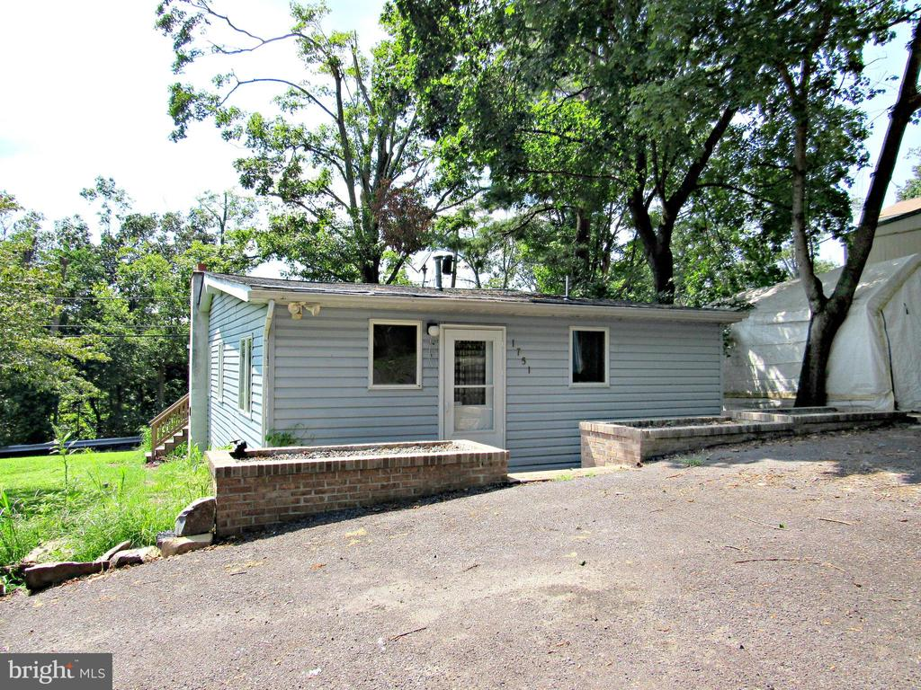 """Cute & Cozy bungalow perched above the Perkiomen Creek and Montgomery County Trail System provides endless opportunities for recreation.  Newer front deck & newer Heating/AC.  Many nice features at a very good price.  Inspections are welcome but property is being sold in """"as is"""" condition."""