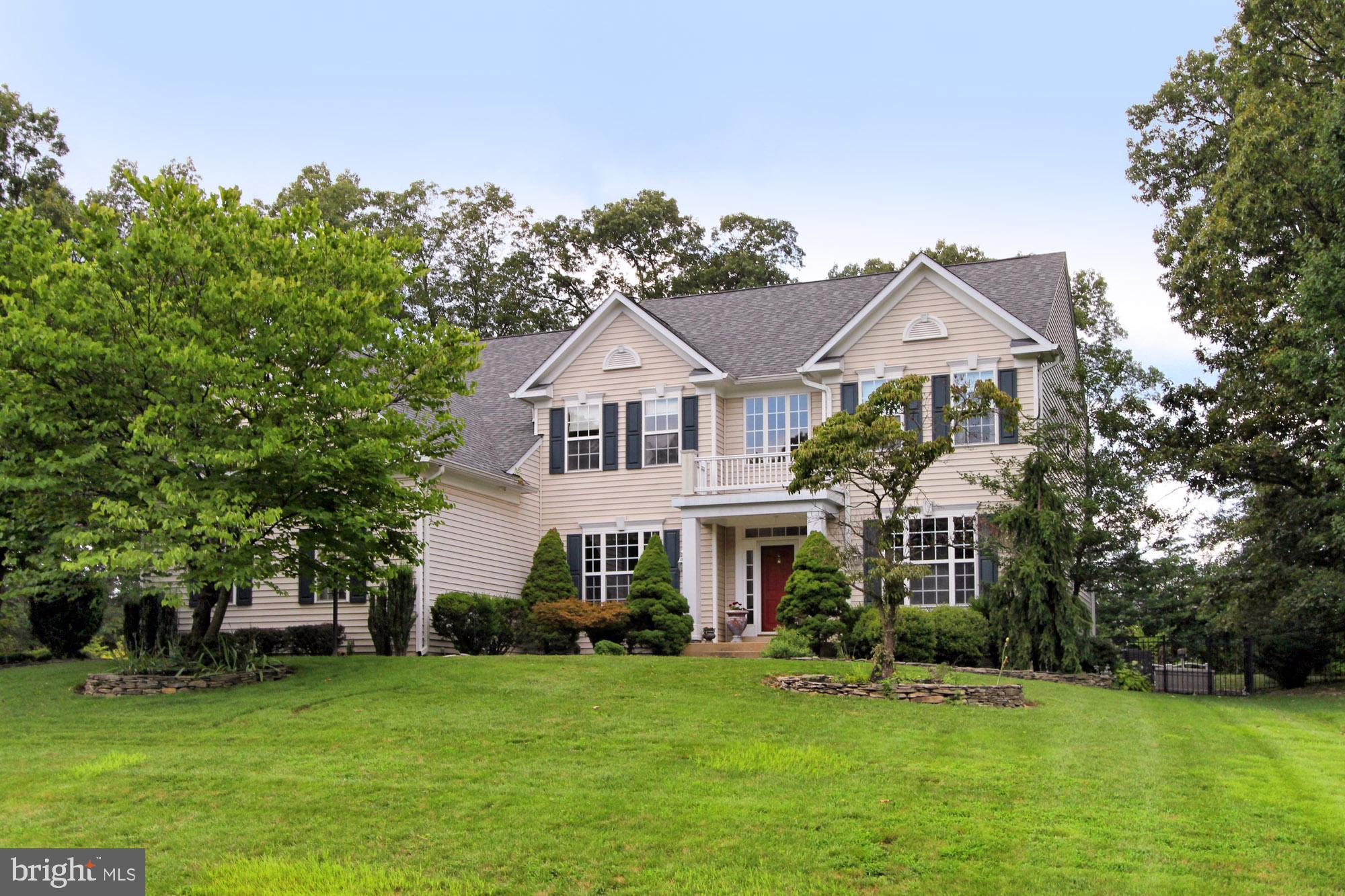 This beautiful 4 Bedroom, 4.5 Bath Colonial is located on the end of a quiet cul-de-sac in the sought-after community of Hollymeade.   Features a spacious floor plan with three finished levels on almost 1-acre homesite and built-in heated swimming pool.  Appointments include a 3 car garage, hardwood floors, and new carpet in the bedrooms, family room, and basement.  The kitchen has been updated with granite and stainless appliances.  The upstairs laundry room has a high-efficiency, front-loading washer, and dryer.  The lower level features a full bath, workout room, a generous living area, and a spacious storage room. Recent maintenance and renovations include a new roof, freshly paved driveway, and beautifully renovated bathrooms.  Hollymeade is in close proximity to top-rated Fairfax County schools, shopping, and the famous Lorton Workhouse Arts Center!