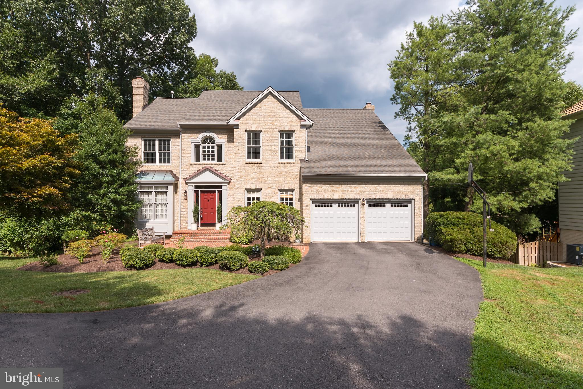 Stunning three-level brick front home with over 4,600 square feet in picturesque Springfield Glen! Featuring an elegant two story foyer, formal living room & dining room -- this is the perfect space to welcome and entertain your guests! The spacious kitchen boasts a center island, breakfast nook, ample cabinet & counter space, and plenty of pantry space. Cozy up by the fire in the light-filled den with beautiful french doors opening to a new top-of-the-line Trex deck. Rounding out the main level is a functional laundry room, an updated powder room, and a stately study with french doors for privacy while working from home! Ascend the curved staircase to the upper level with three spacious bedrooms, one bathroom with dual vanities, stall shower, and separate tub. Perhaps the most stunning feature on the upper level is the luxurious master suite, which features an oversized master bedroom with a trey ceiling, walk-in closet, and spa-like master bathroom. The finished, walk-out basement with wet bar, full bathroom, and several storage rooms is totally customizable to fit your needs -- media room, family room, or in-home gym -- the options are endless! Enjoy the outdoors on the patio or dine al fresco on the beautiful deck overlooking trees, lush landscaping, and Cross County Trail. Parking is a breeze with a two car garage and large, private driveway. Convenient to major roadways, Metro, VRE, public transportation, shopping, dining, & recreation options and located in sought after school district!