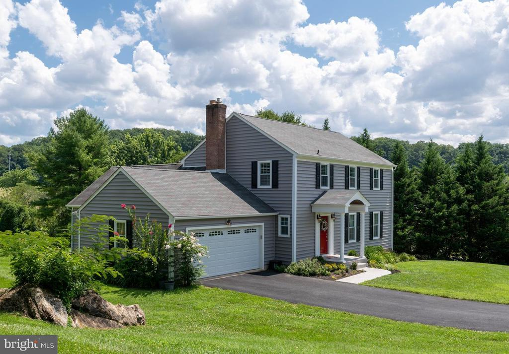 You will Love this 4 Bedroom 3.5 Bath Colonial on .61 Acre Lot Backing to Minebank Run and Open County Space. Over 3,100 sq. ft. of Finished Living Space. You Will Love the Many Recent Improvement the Sellers have done to include: 24x19 Family Room Addition w/Gas Fireplace and 15'Cathedral Ceiling, Recent Siding, Gutters, Front Porch, Stamped Concrete Walkway, Driveway, Energy Efficient Windows, Master Bath, Custom Shelving in Master Bedroom, Plantation Shutters, Recent Paint, HVAC & H2O Heater,  White Cabinetry in Kitchen w/New Stainless Kitchen Appliances, Finished Lower Level with recessed LED Lighting and Walkout exit, Wood Floors Throughout 1st Floor and second floor. Potential In Law Suite in Lower Level with Walk out. Private Deck off Family Room with Hot Tub.