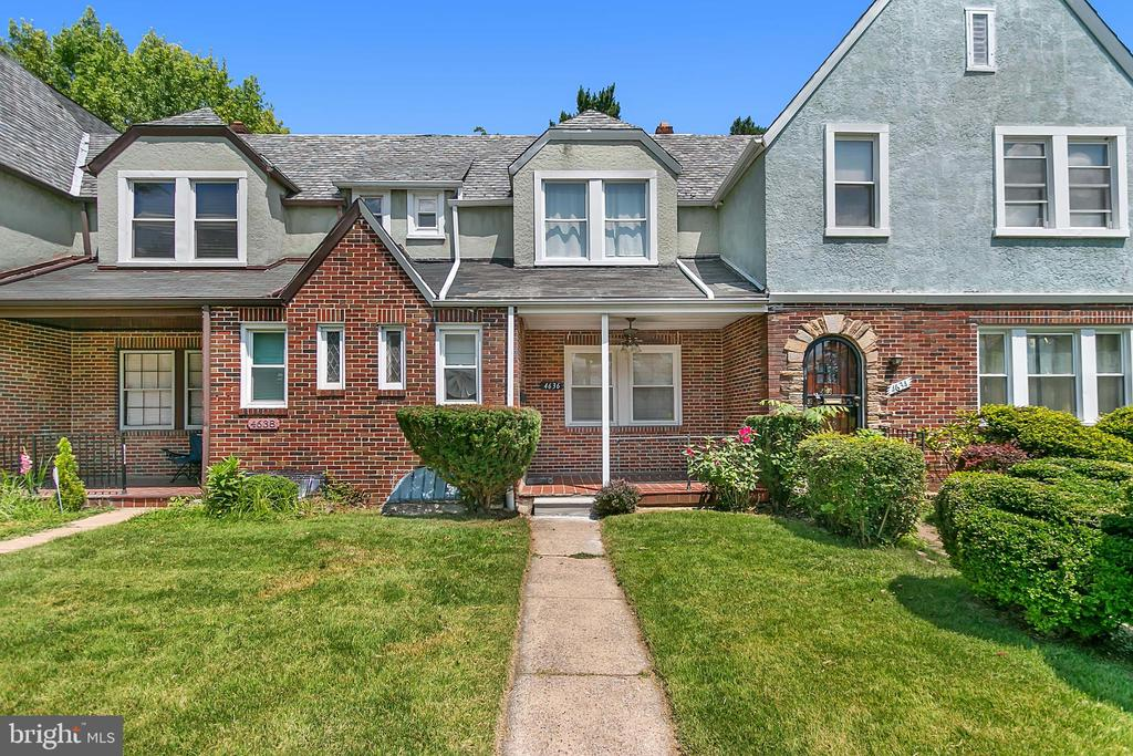 Gorgeous spacious brick row home in the lovely historic neighborhood of Hunting Ridge! Fresh paint, finished basement, one car garage, newer deck off the kitchen and well manicured yard. This gem is turn key and won't last long.  Book your showing today! You will not be disappointed!