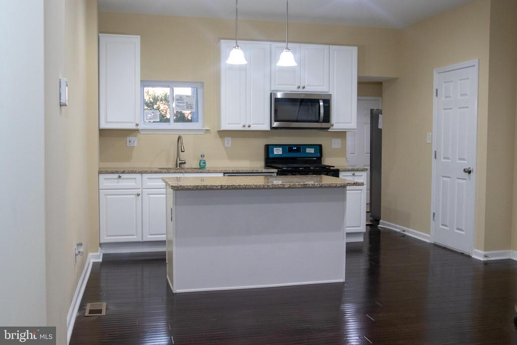 This is a Beautiful Fully renovated 3 Bedroom 1 1/2 Bathroom Row Home. Located in Northwest Baltimore.  Brand New Roof, HVAC, hardwood floors, tile and carpet. Stunning Kitchen with granite counter tops, new cabinets, High End Stainless Steel Appliances. Fully Finished Basement with Washer and Dryer. Seller will provide a 65 inch 4k TV at settlement as well as pay for the Alarm System for 1 year, and $400.00 towards Mortgage Insurance
