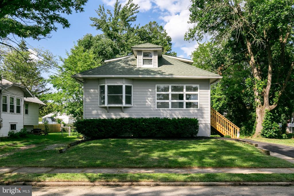 Completely updated and ready for possession. This adorable home with a large yard is close to everything. White cabinets in the kitchen with gorgeous counter tops.  New baths and painted in the most popular of color tones.  Easy maintenance with a full basement.