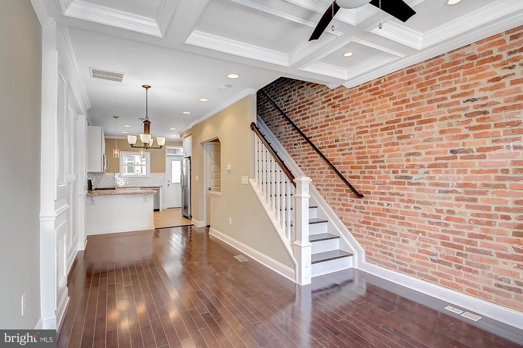 Newly renovated 4 bedroom, 3.5 bath town home w/fully fin basement & tons of upgrades. Large custom kitchen by Canton Kitchens w/SS appliances & granite. Beautiful ceramic tile baths, deck, hardwood floors, coffered & tray ceilings, Exceptional finishes, trim & tile work-MUST SEE! Steps to Patterson Park & Public House! (Pics are of similar house renovated at the same time).