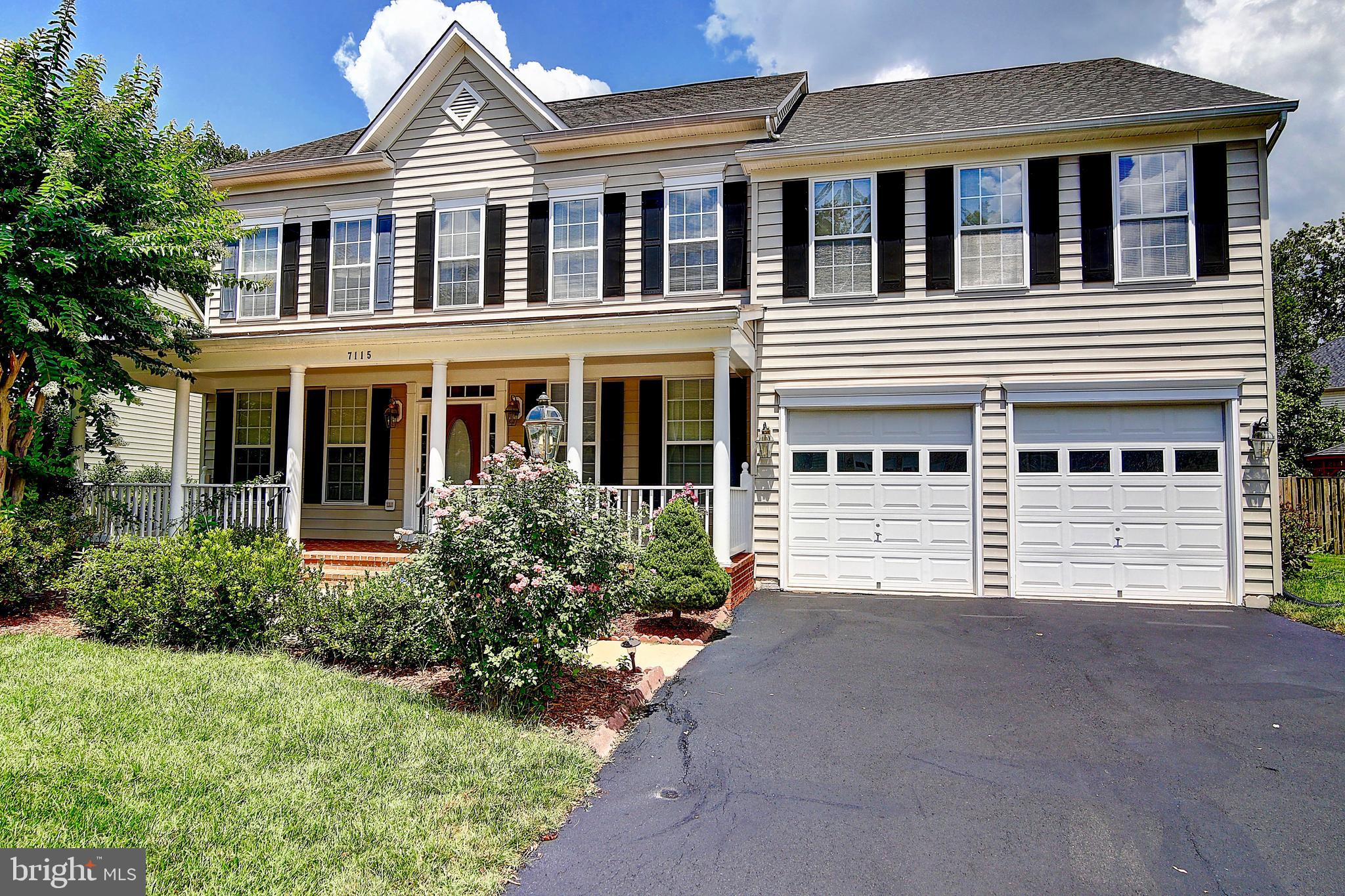 SELLERS WILL REPLACE ALL CARPETS WITH ACCEPTED CONTRACT, Beautiful colonial with two-story living room and stunning custom stone fireplace. Hardwoods throughout main level, eat-in kitchen with island and formal dining room. Escape to the grand master suite at the end of a busy day, with cathedral ceilings and an en suite master bath with soaking tub and separate shower. The finished basement features a full bath and kitchen area with sink and dishwasher, perfect for guests or entertaining. Rear deck and large lot. This home has it all! Welcome Home!