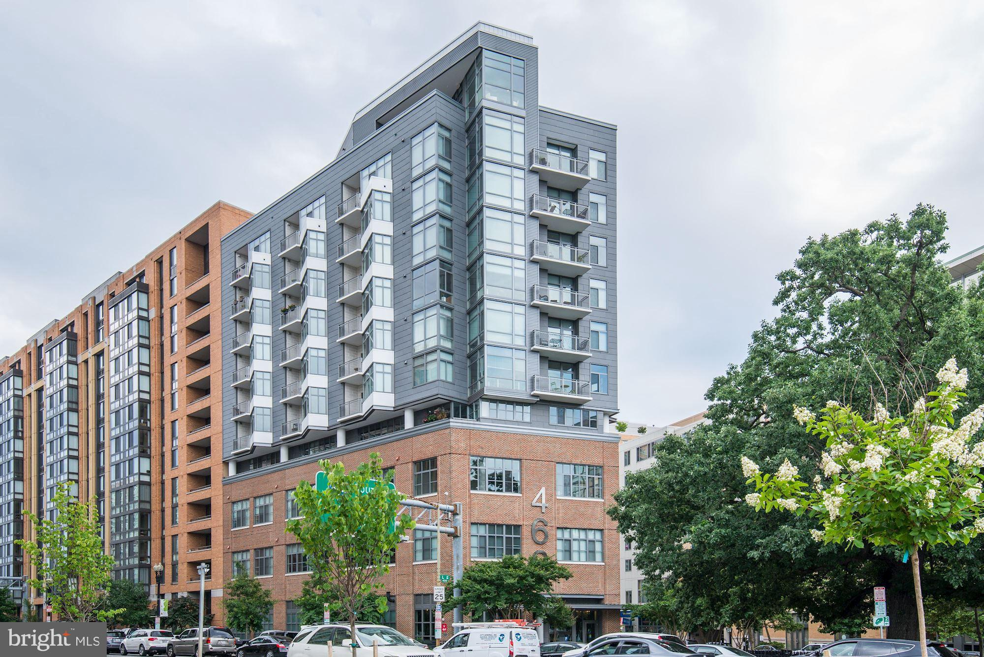 Welcome to 460 New York Avenue NW. This a large one bedroom and one full bath with a private balcony, garage parking and extra storage. This corner unit is located on the 8th floor with dramatic floor to ceiling windows, and freshly painted with several improvements including new water heater (9/2018), Hydroviv water filters, new shower head, ELFA custom closet organizers in entry and bedroom closet, updated light fixtures, outlets, and switches. As part of the 460NYA Condos amenities, VIDA Fitness will offer discounted membership and also there's laundry pick-up/delivery service. Great entertaining space in unit as well as a gorgeous rooftop with amazing views!Walk Score of 96 out of 100. This location is a Walker~s Paradise so daily errands do not require a car.460 New York Avenue Northwest is a six minute walk from the  Green Line and the Yellow Line at the MT VERNON SQ/7TH ST-CONVENTION CENTER stop and the Red Line is at the Gallery Place/Chinatown stop.