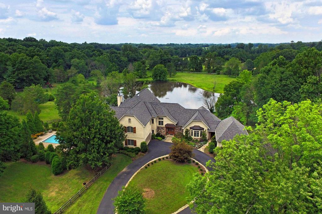 Gorgeous French Colonial Estate with Lake views.  This home is close to all the amenities with that private retreat feel.  Custom home on 5 acres in Clifton.
