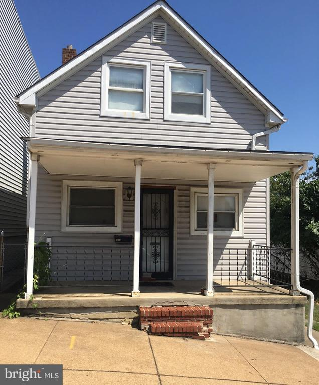 Well priced single family home with full basement and Two detached garages. Fenced yard. Easy access to downtown Baltimore and to DC commuter routes.