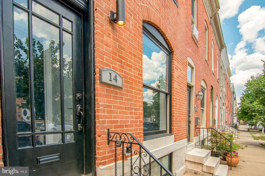 CHAP CREDIT FOR BUYERS IS APPROVED! Breathtaking fully renovated row with high end finishes throughout! Huge kitchen with two tone cabinets, upgraded finishes, counter tops & appliances. Private parking pad in the back, in addition to available street parking. This property offers four bedrooms, including two master suites and a third bedroom on the top floor. Leading up to the rooftop deck, the perfect place to finish out your summer! Every bathroom offers varied custom tile and upgraded finishes, each one more gorgeous than the last! Fully finished basement offering 4th bedroom and 3rd full bath. Tons of storage and living space! You don't want to miss an opportunity to see this charming Canton row.