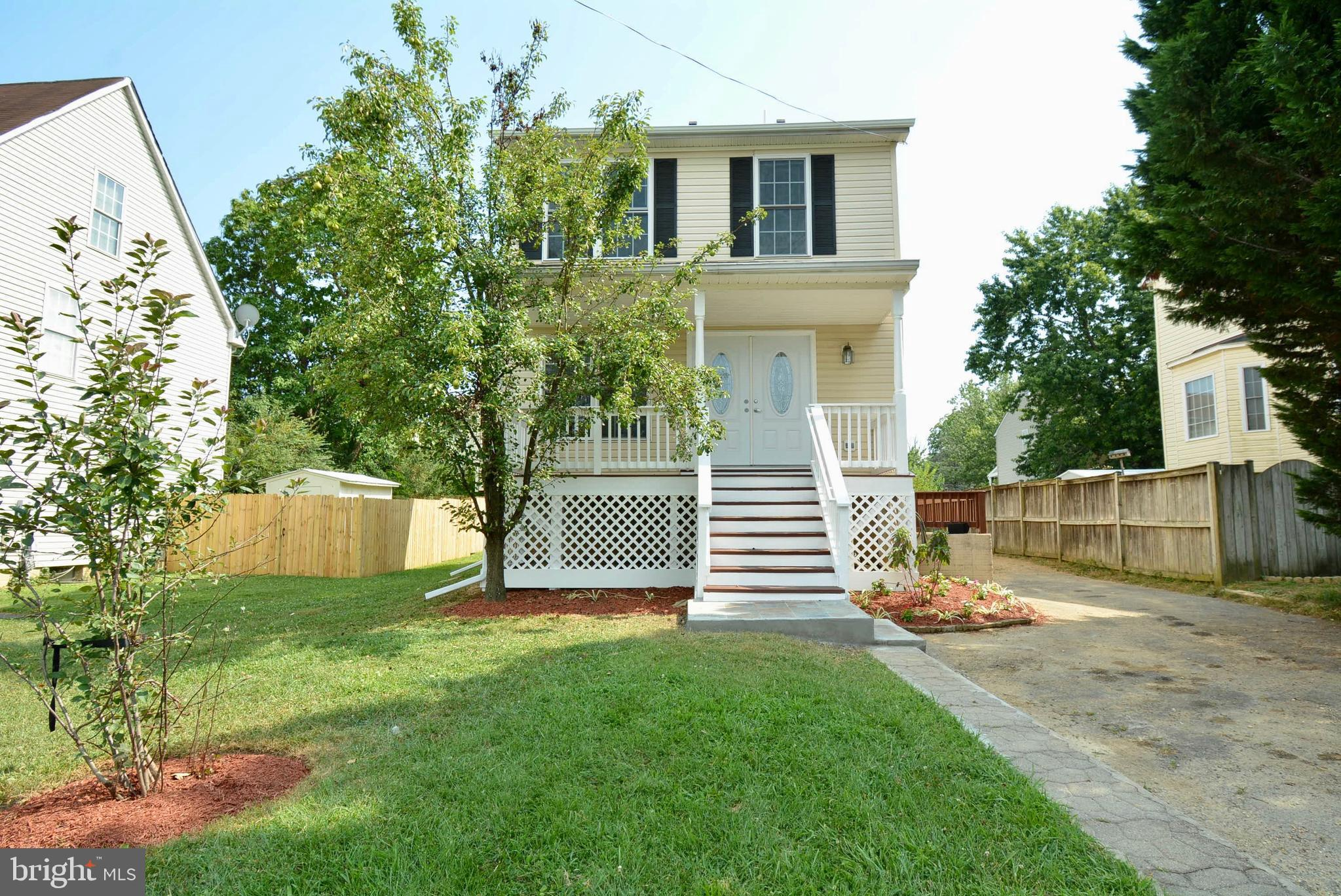 """HUGE PRICE REDUCTION!! This is a """"MUST SEE INSIDE!  LITE-BRIGHT- READY FOR NEW OWNER! KITCHEN  AND BATH REMODEL!  OUTSIDE ENTRANCE TO BASEMENT/FULL BATH AND BEDROOM!  HUGE DECK ACROSS BACK. NO HOA, GREAT COMMUTE, VACANT! HURRY--GET IN FOR HOLIDAYS. SHOW & SELL!"""