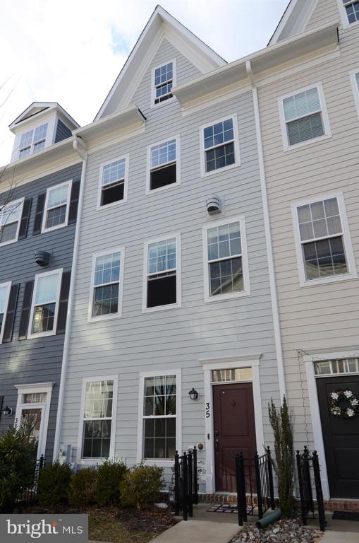 Entire house is being repainted neutral/grey and carpet on main stairs to be replaced. Convenient living in quiet neighborhood near the heart of Towson. Entry level den/office. Bright, open main level LR/DR/KIT, Gas FP in living room. Kitchen features stainless appliances, granite counters, island w/seating, desk area, and pantry. Main level powder room. Master bedroom with walk-in closet and 2nd bedroom with en suite bath on 2nd level. Laundry on bedroom level. Top floor can be bedroom (has full bath) or family room. Deck off upper level. Large walk-in floored attic for storage. 2- car garage plus permit parking on the street. Close to all Towson amenities. Sorry, but owner is not accepting vouchers.
