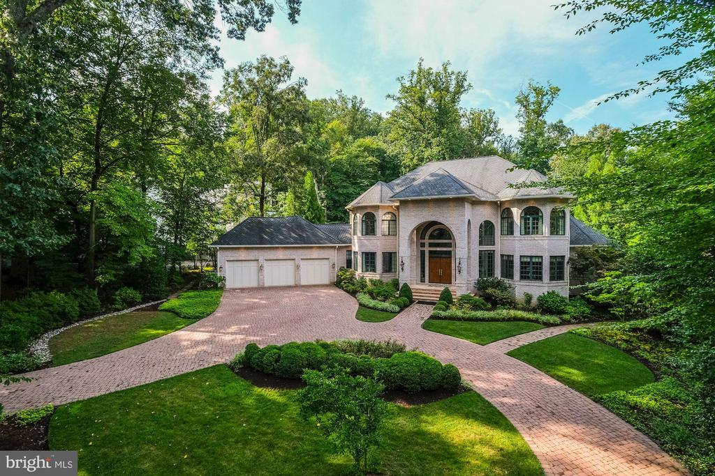 A rare opportunity to own an architectural masterpiece constructed by award-winning Bowa Builders. The home was thoughtfully designed by the original and only owners once they found their ideal setting for their vision in Bethesda's sought after Longwood neighborhood.  The grandeur and meticulous craftsmanship are immediately evident once you turn into the circular driveway to the home.  In the interior,  with its soaring two-story entry  and living area, the richness of the materials and finishes is apparent.  One cannot help but notice from all windows the lovely views the lush landscape that surrounds the home. This effect was masterfully executed with the strategic placement of the home on the .90 acre lot.  The home has a master suite on the main level and four additional bedrooms, all with en-suite baths. Therefore, one-level living is a definite option.  The lower level is a world unto itself with a second kitchen, immense oak bar, home theater and exercise room.  A custom- made elevator makes it easy to access all three floors of the home. The property lends itself perfectly to large-scale entertaining, both in the interior and exterior.  The 20X40 heated pool has a retractable cover. The pool house has a large full bath and changing area.  The surrounding  manicured gardens, pergola, patios and outdoor gardens are  picturesque. Elegant throughout, this home exudes individuality and style.
