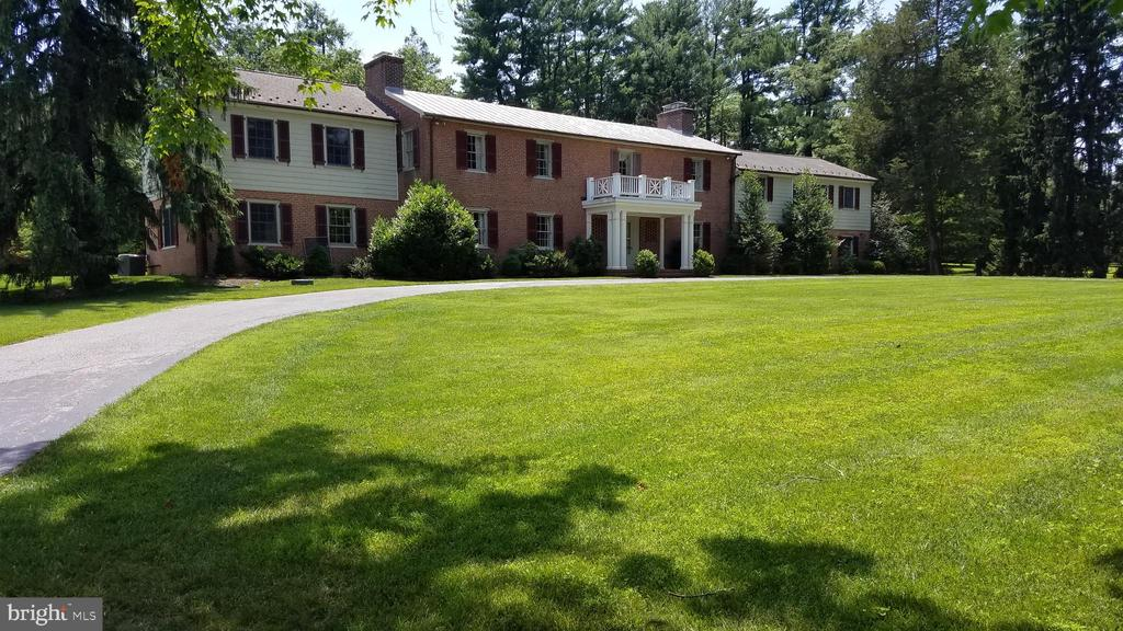 Wonderfully private location on Gateshead Road by Loch Raven Watershed.   Perfect for the large family featuring five (5) Bedrooms and five (5) Bathrooms.  Random width Williamsburg style hardwood and pegged flooring.    Large two and one half (2.5) acre site with tennis court and circular front driveway.  Floor plan features an excellent opportunity for entertaining or for large family holiday gatherings.   Two new HVAC units and twelve new Anderson windows.  All Earnest Money Deposits (EMD) shall be held in escrow by listing broker.