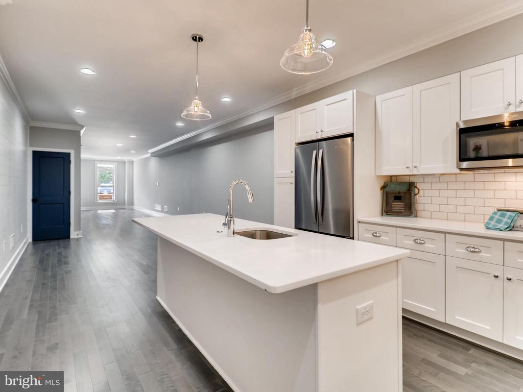 Amazing new renovation just finished and ready for rent.  This home is huge with open floor-plan first floor.  Gourmet Kitchen with quatz coutnertops and brand new stainless steel appliances.  Fenced in large backyard with 2 car parking pad.  Amazing owner's suite with large walk in closets and spa bathroom.