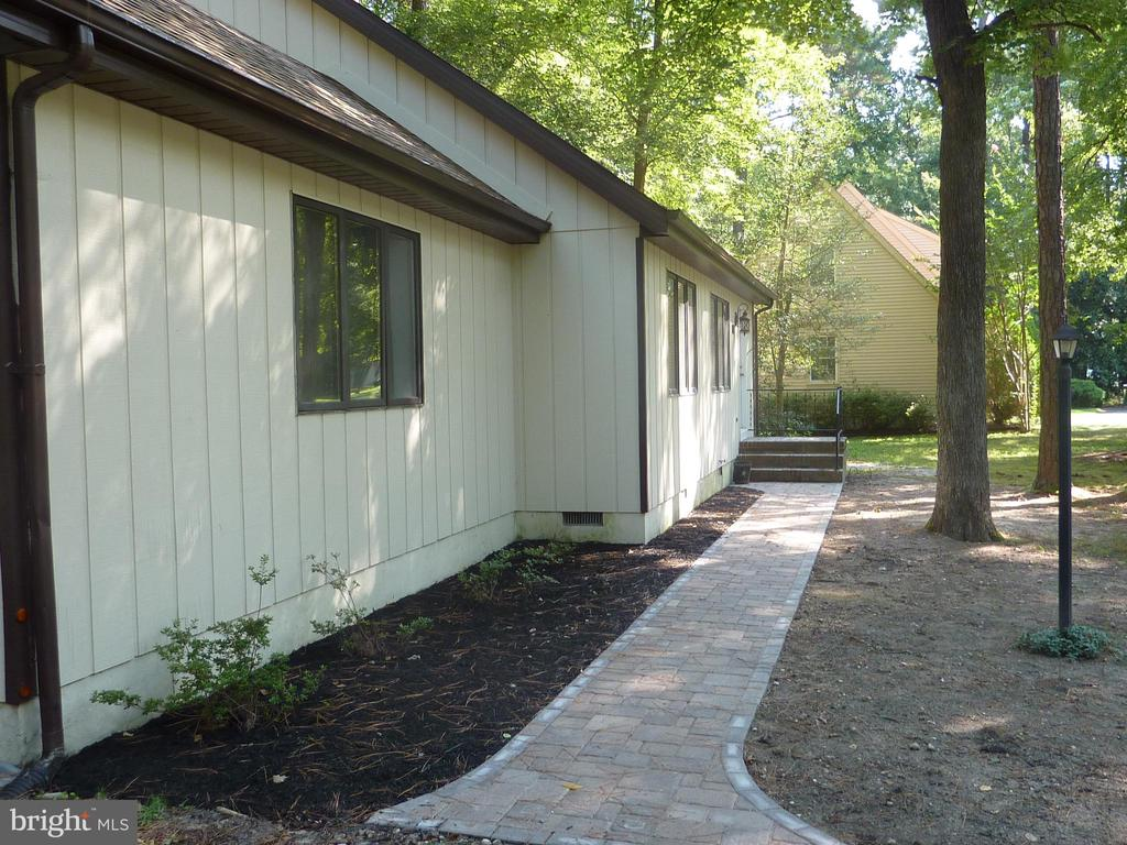 """Cape Cod exterior, Contemporary interior. Cathedral ceiling in living/dining area with second floor balcony running length of the house. Laminated wood floor in living room, dining room and master bedroom. Luxury vinyl tile floors in kitchen and bathroom.  New kitchen cabinets, appliances and water heater. 3 bedrooms, 2 baths and a two car garage. Sidewalk to front door is made of pavers. Wooded lot and Fruitland school district. Brick fireplace but insert """"as is"""". Freshly painted inside and out. Main roof 9 years old, garage roof new in 2019."""