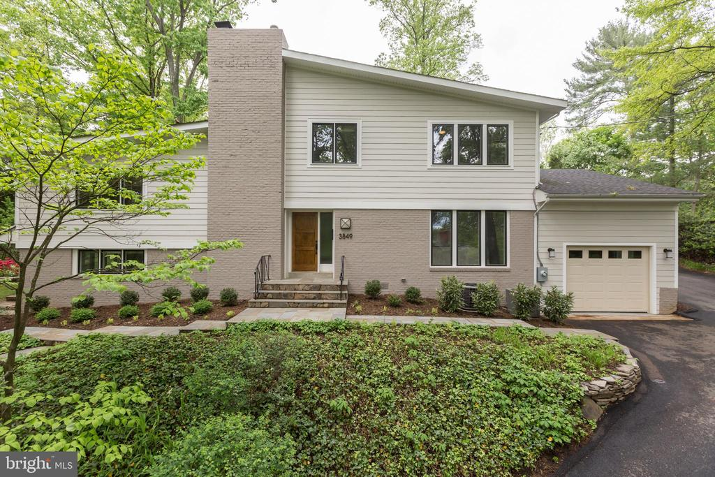 This beautiful home is located in Bellevue Forest, a highly sought after neighborhood in Arlington, Virginia. Surrounded by lush greenery, flat usable backyard, it is an oasis from busy city life, yet located mere minutes from Washington,DC.  It's a quick hike to the Potomac River and Donaldson Run Park and conveniently located between McLean, Virginia and the busy Arlington's urban villages of Rosslyn, Courthouse and Clarendon. Entering this home, you are greeted by a modern and chic design. Its sensational open, main floor plan allows you to live and entertain in-style. This level is an open and inviting space and features a spacious living room and dining room, gourmet kitchen, breakfast room and access to home's backyard, all framed in a lush, green, natural setting.You also have direct access to the home's garage for easy entry. A few steps down, you'll find the home's family and powder rooms. A separate utility room is also found on this level, as is access to the garage,providing added convenience. The living room features gorgeous hardwood floors, a wood burning fireplace and walls of windows, showcasing the home's tranquil setting and creating a peaceful ambiance. The dining room can accommodate intimate dinners and larger gatherings, having enough space to welcome numerous guests. Located directly off the kitchen is a separate breakfast area, perfect for casual dining. Speaking of dining, the gourmet kitchen is impressive in style and form and is the heart of the home. The open plan setting allows you to cook while being part of the action with friends and family. Its many windows and skylights provide abundant natural light. Both the tiled flooring and tiled backsplash highlight the home's modernity. An over-sized refrigerator, large built-in microwave and stove, dishwasher and island sink provide the necessary modern conveniences that make this kitchen a chef's delight. And, a door to the outside patio allows instantaneous alfresco dining and expands the