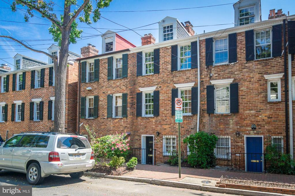 New price! Open this Sunday, September 22nd, from 2 - 4pm! Charming East Village brick townhouse with four fireplaces, close to Rose Park and other Georgetown amenities - equal proximity to Dupont and Foggy Bottom metro.  First floor is entry, kitchen, powder room, dining room and walk out to delightful terrace. Second level has spacious living room and an office/den with built-ins that could also be a third bedroom.  Top floor has two bedrooms and one bath.  In addition there is an attic with pull down stair that is perfect for storage and an unfinished basement for laundry, utilities and storage. Conveys 'AS IS'.