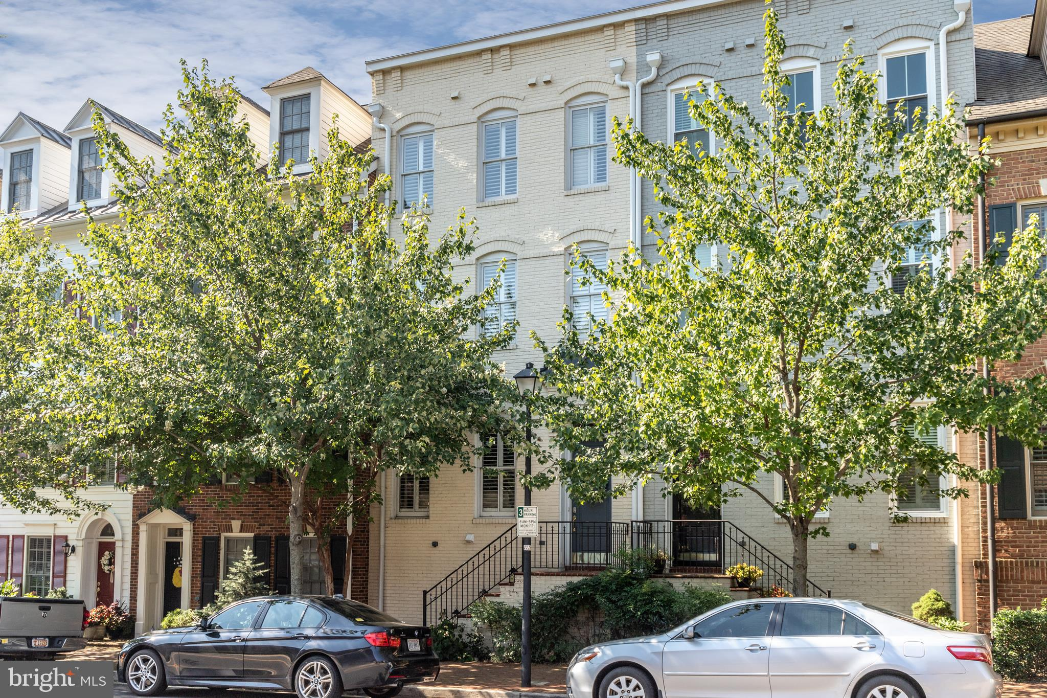 """Stunning 4 level 2 car garage town home is a mere 4 blocks from the water in Old Town Alexandria! Open the door and step onto a custom slate entry highlighted with a wall of natural stone!  Gleaming hardwoods greet you as you easily walk from the large living space to the dining area and the bright kitchen beyond! This gorgeous home in Chatham Square boasts a totally updated open floor plan with a gourmet chefs kitchen, high-end appliances and a large island with bar seating! Upscale plantation shutter adorn the windows and make for convenient living. The lower level boasts a 2-car garage with loads of storage and a custom media room with a 75"""" large screen TV and a gas fireplace! The second level has a large master suite complete with large walk-in closet and a spa-like master bathroom with a soaking tub, large shower and dual vanities! The second bedroom has another full bathroom along with another walk-in closet. Continue up to the 4th level and be greeted with a large open flex space which can be easily used as an office, family room or guest area! This is also the level where you can step out onto the Roof-top Terrace and sit and relax. This home also conveys with a lovely Pagoda which provide shady relief when needed.  This is truly a rooftop Oasis!  The third bedroom is also on this level with the third full bathroom. Two HVAC units also make for comfortable living! The upstairs Heat Pump was replaced in 2018! This home is a short distance to Trader Joes, Harris Teeter and a plethora of Old Town shops, restaurants and trails and parks. Chatham Square even boasts its own tot lot! Enjoy the ease of Old Town living where everything is short distance away! Welcome Home!"""
