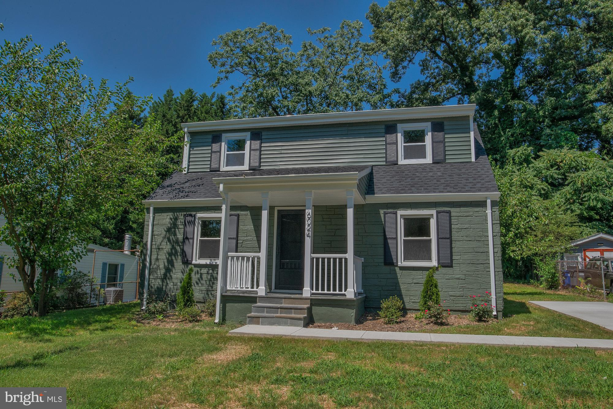 Like Brand new! Two amazing levels, Very nice lot, commuters dream! 3 bedrooms, 3 full baths Popped top and added upper laundry room, two bedrooms & two full baths. Quartz counters and top line stainless appliances Big new driveway for plenty of parking. Walk to Huntington Metro.