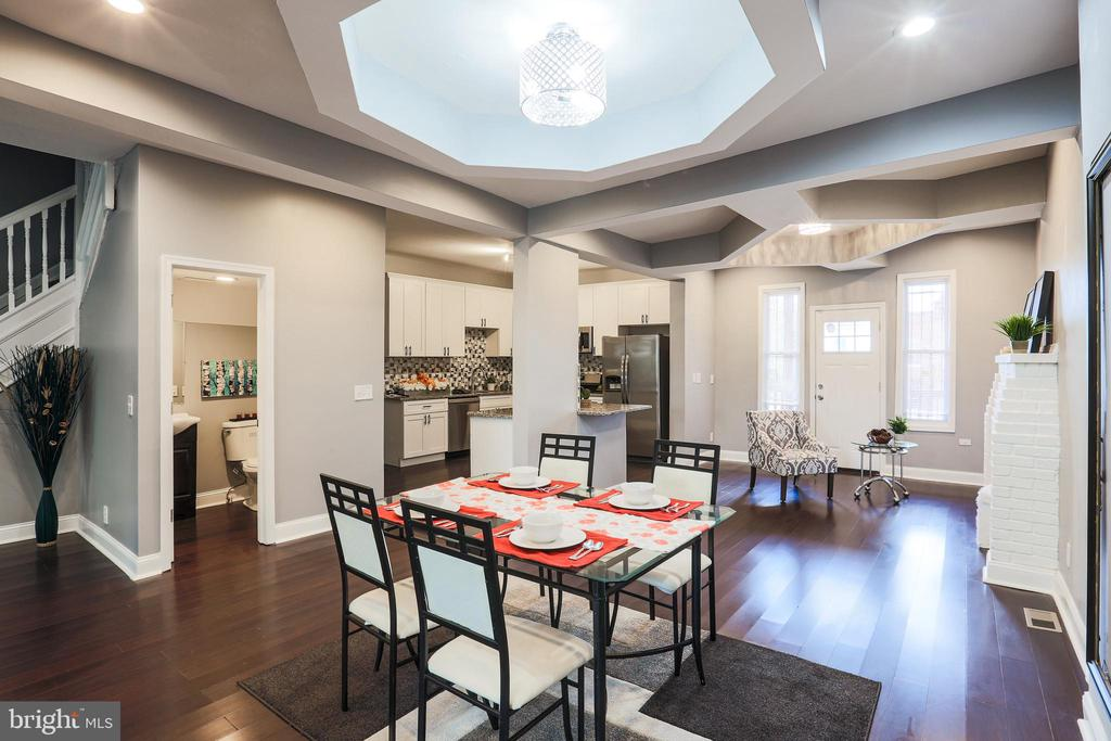 Not your average remodeled home.  This 4 bedroom with attached master bath in Reservoir Hill is one a kind. Upper level bedroom is a real get away with a roof top deck.  Full wet bar with refrigerator.  Attached bath with separate  whirlpool tub, Two zone central a/c and heater with separate Honeywell thermostats, two outdoor decks. Renovated one car garage with new garage door and windows Main level tray ceilings and light fixtures are absolutely stunning!!  Close to Maryland Zoo, Druid Lake Park, and JFX