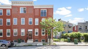This updated 3bd/2.5ba rowhome is minutes away from Union Square and Hollins Market. The living/dining room combo features exposed brick and laminated wood floors. The kitchen has a dishwasher and hood microwave for added convenience and access to the private backyard. The laundry room is located on the upper level for convenience and the master suite is on the top floor for added privacy.