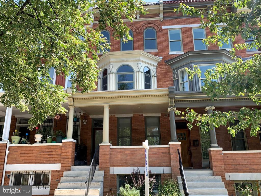 """Modern Open Plan Living in Reservoir Hill. This wide, porch front, light filled home is brimming with modern design and technology. Whole house sound system, hidden wiring for sleek media areas in the living room and third floor den, thoughtful storage areas, energy efficient appliances, multi-jet showers, and an open rail staircase with lighting under the treads. Upstairs you'll find three large bedrooms, each with their own bathroom as well as a media room/den with a wet bar and door leading to a rooftop view of downtown. The master bedroom features a large closet area and a bathroom with dual sinks, air tub with chromotherapy, and multi-jet shower. Laundry is just outside the master bedroom. The front bedroom has a hall bath and a large bay window at the front. The third floor bedroom is filled with light from the large skylight and windows. The bathroom has a large tiled shower stall, floating vanity, and light up mirror. This block of Linden has exceptionally long backyards - a rare find in the city - with enough room for a deck, patio, garden AND two car parking!Features include::In-floor heating in Master bath, Dual zone HVAC, Whole house ventilation fan. Tankless water heater. Satellite ready (there~s a conduit to the roof)Intercom. Whole house audio with multiple inputs - ~Sonos"""" ready, wired for sound with in-ceiling JBL speakers. Intercoms and CAT-5 high speed internet and cable-ready in every room. Security camera wiring in place."""