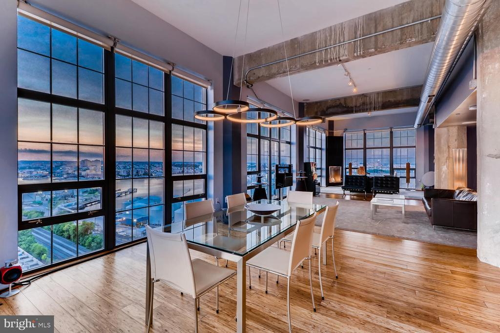 This magnificent and architecturally unique Silo Point Tower corner condominium offers panoramic water and downtown skyline views from triple exposures. Boasting over 2,200 square feet of living space, this 16th-floor two bedroom, two and half bath residence showcases dramatic oversized floor-to-ceiling windows, soaring 11-foot ceilings, Lutron motorized blinds, surround sound speakers, nest thermostats, private balcony, gorgeous eucalyptus hardwood floors that set an elegant tone and backdrop for both everyday living and entertaining. The grand living and dining space lead into the open chef's kitchen with expansive center quartz island, seamless quartz backsplash, European custom cabinets and professional grade KitchenAid appliances with induction range. The luminous master suite features floor-to-ceiling windows with magical water views, custom closets and en-suite spa bath with a separate shower, soaking tub and dual vanities. Five coveted garage parking spaces including one electric car charging station. Live the Silo Point Sky life with full service amenities; including 24-hour concierge, premier building manager, fitness center with adjoining yoga studio and private treatment room, boardroom, game room and 19th Floor Sky Lounge. Easy access to I-95 and water taxi.