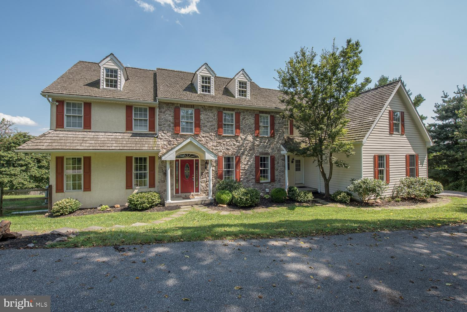 """Elegant Custom Built Home with gorgeous views of beautiful Chester County at it's finest.  Stunning front to back Center Hall flanked with Formal Living and Dining Rooms, Gleaming Hardwood Floors, Wrought Iron Spindles on Stair Railing, Wood Trends, Custom Millwork & Recessed Lighting throughout, First Floor Private Study, Two Powder Rooms, Gourmet Kitchen offers: Hardwood Floors, Granite Counter Tops, Gas Cooktop, Tile Backsplash, Wet Bar Area with Wine Cooler, Two Pantries, Stunning Cabinetry, Chef's delight with a Large Island with a Double Sink, adjoining Morning Room/Breakfast Room with French Doors leading to Brand New Trek Decking with Cable Railing to enjoy a clear view of the pastoral views.  Vaulted Family Room open to Kitchen, Floor to Ceiling Stone Wood Burning Fireplace with Gorgeous Views out every window.  Luxurious Master Bedroom with a atmosphere light in the Tray Ceiling, French Door to Private Balcony, Walk-in Closet, Full Bathroom with 18"""" Tile Floor, Jetted Soaking Tub, Two Separate Vanities, Oversized Tiled Shower with Seamless Glass Door, Separate Toilet Closet & Linen Closet.  Prince/Princess Suite with Double Closet, Full Tile Floor Bathroom with Double Sinks, Door to Tub/Shower/Toilet Area, Second Floor Laundry Room with Shelving & Sink.  Very Spacious Bedroom with Lots of Closet Space and a Bonus Room.  Two Additional Bedroom share a Jack-n-Jill Bathroom with Tile Floor and Tub/Shower Combo.  Full Walkout Basement with a SwimEx Lap Pool Room with a Full Wall of Nano Doors to Open to the Outdoors.   Full Custom Bathroom with a Steam Multi Head Shower, Unique Tile Backsplash with a laser cut outline of pre-9/11 NYC, Vanity with Corian Counter Top, Tile Floor.  Endless Possibilities for this fabulous unfinished area that offers plenty of light and Amazing Views.  Fenced in Backyard, Storage Area under deck.  A short walk to Historic Marshalton Inn/Four Dogs Pub, Mins. to Downtown West Chester.  This property has it all...the peacefulness of c"""